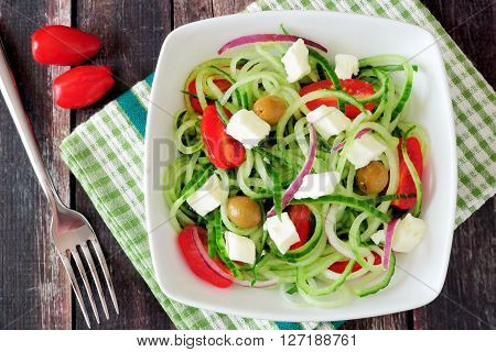Delicious Greek Salad With Cucumber Noodles Above View On A Dark Wooden Background