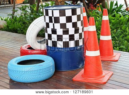 Automotive Safety Concepts Painted Tires with Traffic Cones and Traffic Barrels.