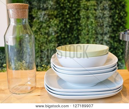Kitchen Utensil Set of Ceramic Dishes Bowls Plates and Glass Bottles Preparing for Serve Hot and Cold Food.