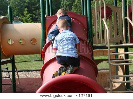 Boys On Tunnel Slide