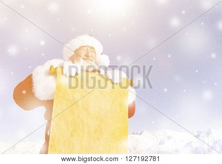 Traditional Santa Claus with a paper scroll.
