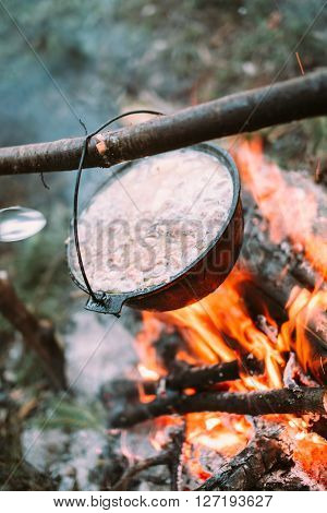 Fish soup to cook on fire in nature. Outdoors photo.