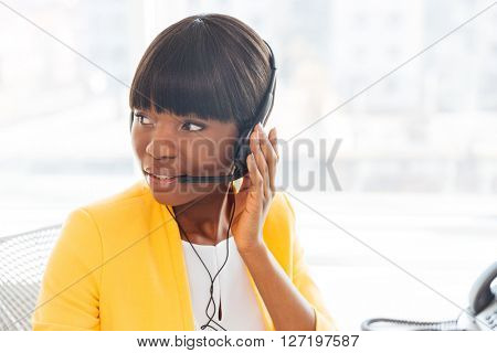 Beautiful afro american businesswoman working in call centre