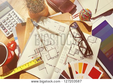 Messy Designer's Table with Sketch and Tools