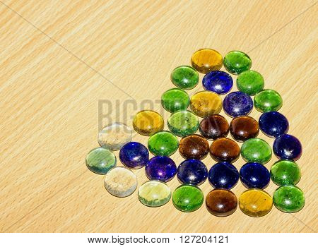 Colored Stones On A Wooden Table, Texture