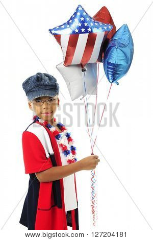 A young elementary girl looking at the viewer as she holds a bunch of red, white and blue balloons.  On a white background.