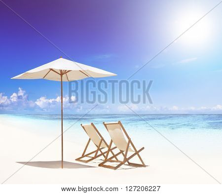 Deck chairs on white sand beach.