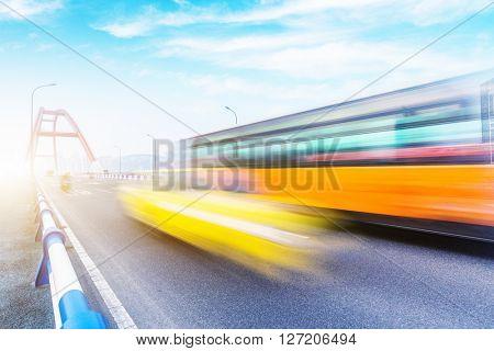 blurred traffic on caiyuanba bridge,chongqing,china,blue toned image.
