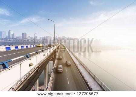 traffic on chongqing caiyuanba bridge,china.