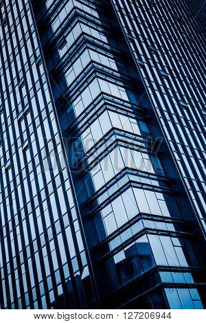 Close up glass building detail in shanghai,china.blue toned image.