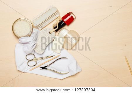 Foot care. Pedicure accessories set tools on wooden board background top view with copy space