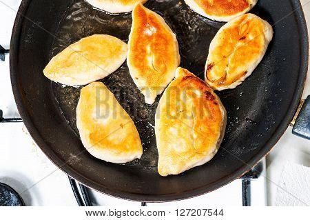 Fried Patties On Pan.