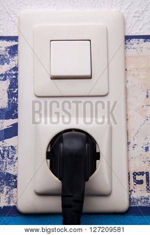 socket and light switch with a plug
