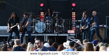 FRISCO, TX-APR 23: (L-R) James Young, Mike Eli, Chris Thompson and Jon Jones (R) of the Eli Young Band perform during the 2016 Off The Rails Music Festival - Day 1 at Toyota Stadium in Frisco, Texas