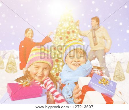 Family celebrating christmas in the snow.