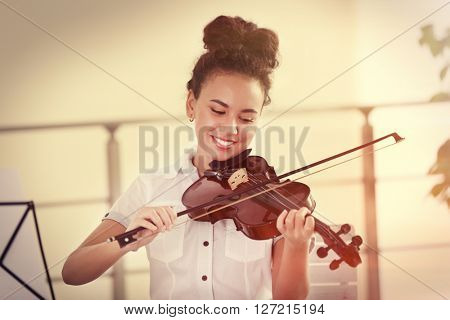 Young girl playing on a violin