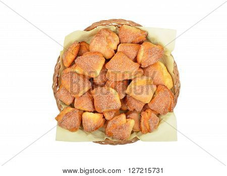 Homemade cookie in a wattled basket isolated on white background