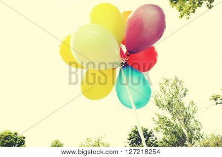 Balloons flying on sky background. Retro style