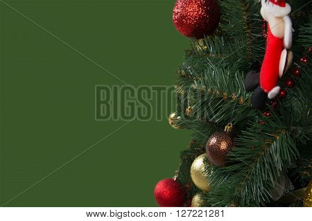 Decorated Christmas Tree On A Green Background, Isolated
