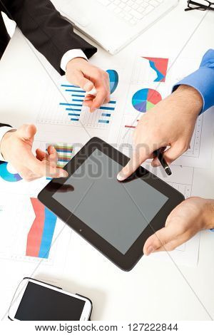 Detail of people at work during a business meeting
