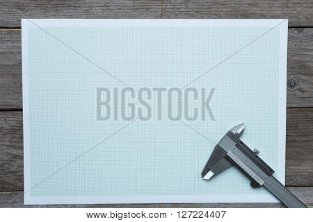 Vernier-caliper on graph paper background and texture
