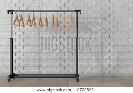 Mobile Black Coat Rack with Hangers in front of Brick Wall. 3d Rendering