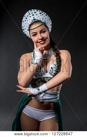 Portrait of beautiful go-go dancer smiling at camera