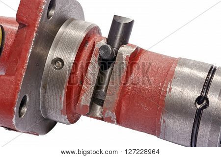 a fragment of a fuel pump in the center of the frame the part regulating the engine speed closeup on white background