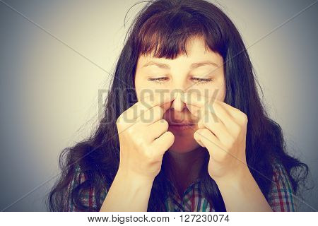 Young Woman Squeezing Pimples On Her Nose