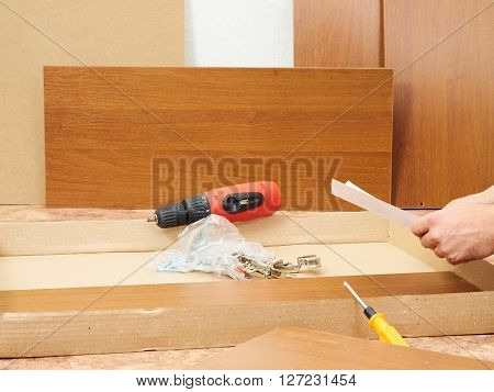 Tool and furniture for self-Assembly. Assembling furniture.