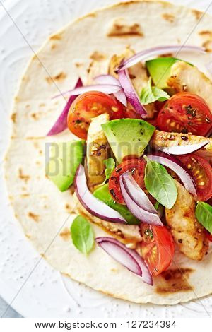 Fajita with grilled Sesame Chicken, fresh Tomatoes and Avocado