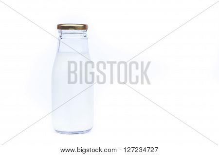 Traditional glass milk bottle on white background, stock photo