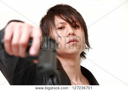 studio shot of a man with a handgun