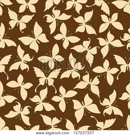 Yellow butterflies silhouettes seamless pattern of dainty insects with open wings randomly scattered over brown background. Use as retro wallpaper or interior textile design usage