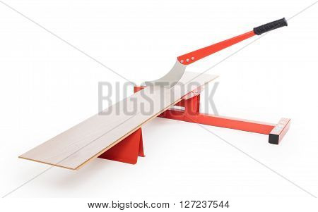Red tool for cutting laminate isolated on white