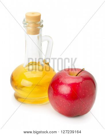 bottle of apple vinegar and apple isolated on white