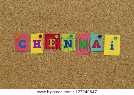 Chennai written on colorful notes pinned on cork board.