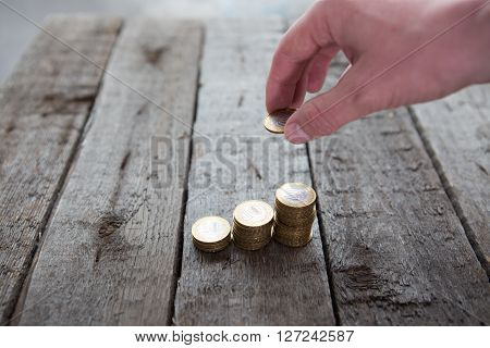 Male Hand Putting Money Coin