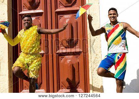 Young Brazilian guys dancing Frevo in Olinda, Brazil