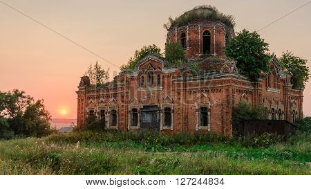 abandoned rural church in the evening. Russia