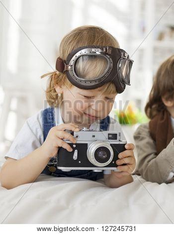 happy boy with retro camera