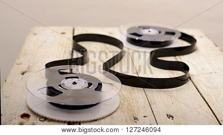 Magnetic tape on  a old wooden background ** Note: Shallow depth of field