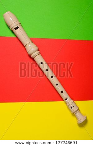 White plastic flute isolated on colored background