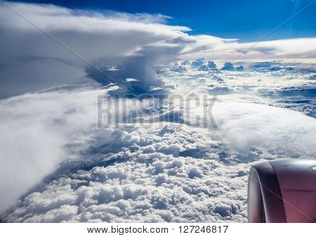 Clouds and sky as seen through window of an aircraft