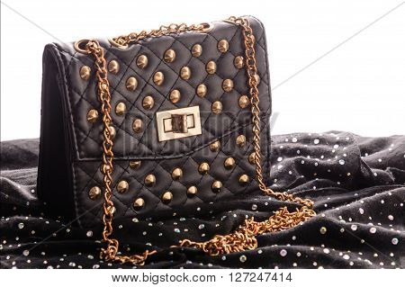 Black leather handbag with silver metal studs jewels and strap white background