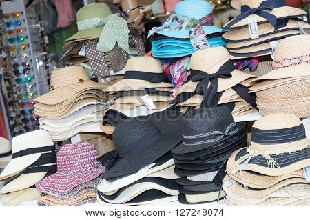 Handmade hats for sale. Hats for sale in a market stall. stall straw hats