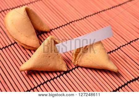 Fortune cookies on a red bamboo mat