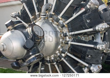 Classic vintage airplane motor engine. Many cylinders around the propeller.