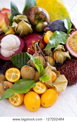 Exotic fruits on white  with kumquats and figs