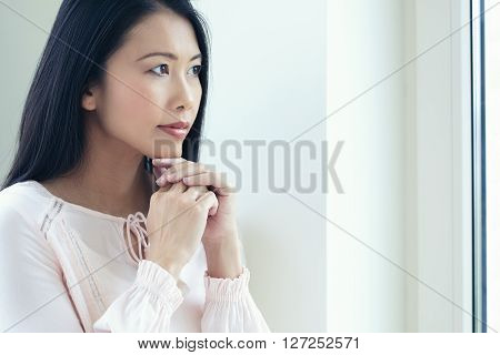 Asian Woman At Window